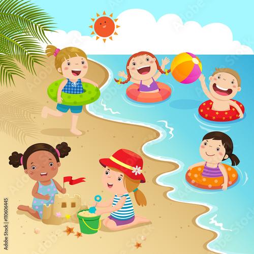 fototapeta na ścianę Group of kids having fun on the beach