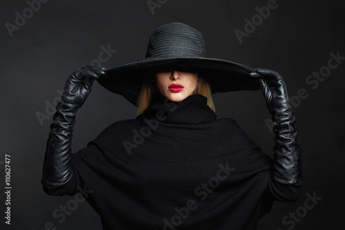 Beautiful woman in hat and leather gloves.halloween witch Poster