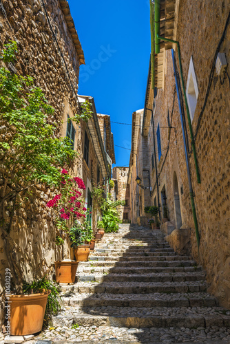 Narrow street with traditional stone houses in Fornalutx