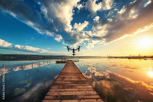 Fototapeta Image of drone over the lake, sunset shot