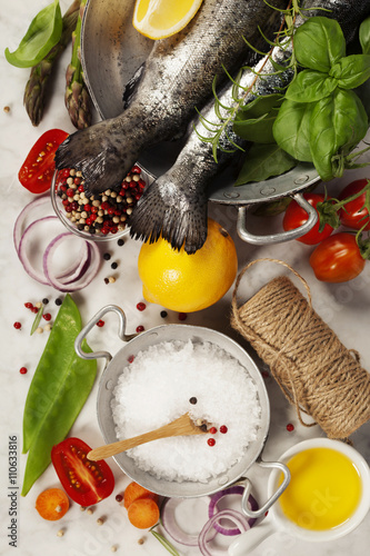 Raw rainbow trout with vegetables, herbs and spices Poster