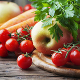 Concept of healthy food with tomato, carrot and apple