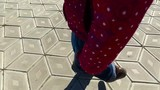 A child walks along the path. The path is covered with diamond-shaped tiles. Videography baby feet closeup. Spring sunny day.