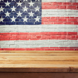Memorial day background with empty wooden table and USA flag - 110660848