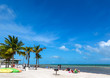 Blue sky with white sand and palm beach in Key West, USA