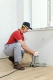 Worker polishing  parquet.