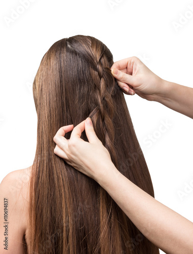 Poster Hands parekmahera braided plait for long hair isolated on white.