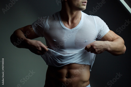 Muscular man with bare torso Poster