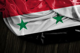 Syrian flag on wooden table