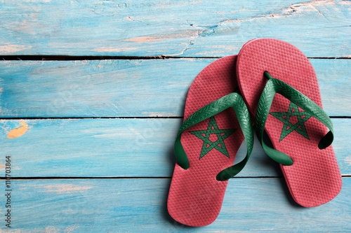 Thongs with flag of Morocco, on blue wooden boards