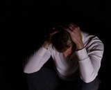 Man showing depression in dark background