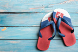 Thongs with flag of Slovakia, on blue wooden boards