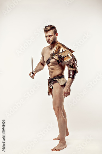 Poster Handsome muscular warrior with sword