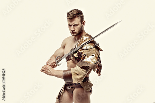 Poster Muscular warrior with sword against of white background