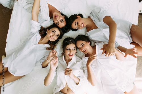 Bride and her bridesmaids in the white clothes