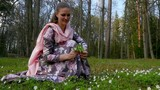 Beautiful girl collecting flowers in a spring Park.slow motion