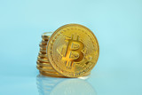 Studio shot of a golden Bitcoin (new virtual money ) Close-up on a blue background.