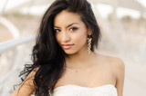 Beautiful exotic young woman with long hair