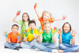 Happy kids with painted hands smiling