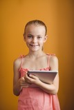 Little girl using a tablet