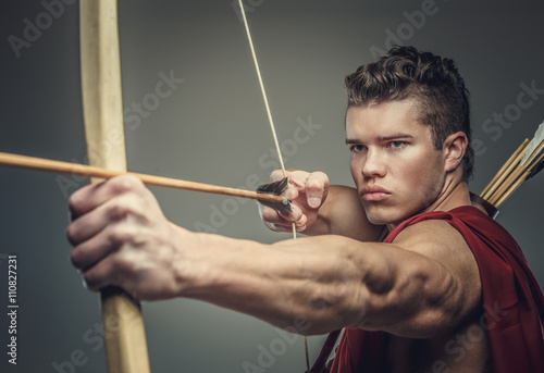 Muscular male model with bow. Poster