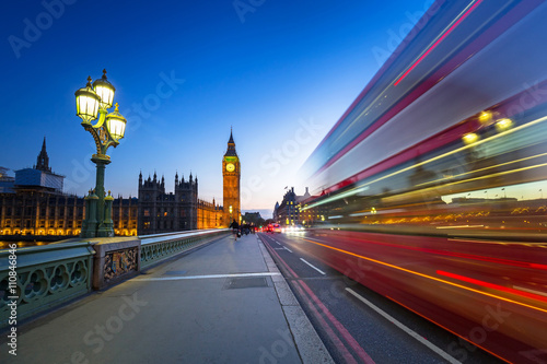 London scenery at Westminter bridge with Big Ben and blurred red bus, UK Poster
