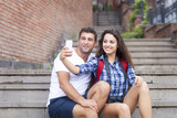 Portrait of a happy couple taking pictures of themselves in the