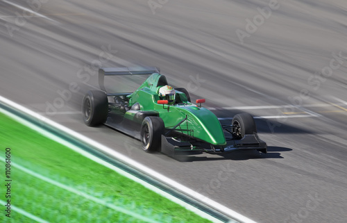 Foto op Canvas Snelle auto s Formula 2 race car racing on a track with motion blur