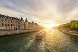 Boat tour on Seine river with sunset in Paris, France