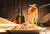 Fototapety spaghetti with amatriciana sauce in the dish on the wooden table