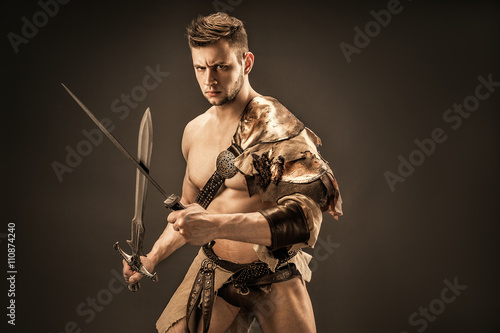 Poster Portrait of angry warrior in leather clothes with swords