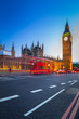 London scenery at Westminter bridge with Big Ben and blurred red