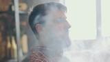 Man smoking electronic cigarette vapor