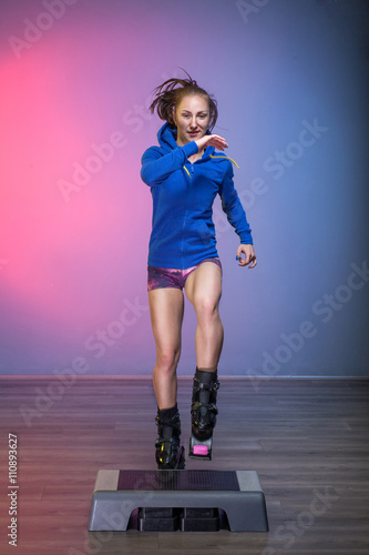 woman exercising with kangoo jumps shoes and stepper. Black Bedroom Furniture Sets. Home Design Ideas