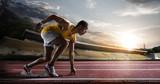 """Sport. Sprinter leaving starting blocks on the running track. 110755723,Woman speaker. Concept image"""""""