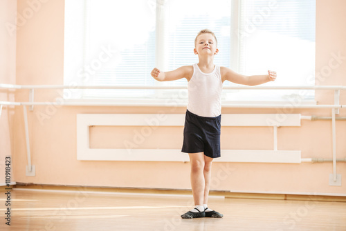 Young boy dancing at a ballet class © Andrey Bandurenko