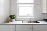 Close up details of contemporary white kitchen with subway tiles