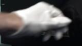 Repair man in white gloves put LCD smartphone screen under vacuum press. Repair smartphone touchscreen display.