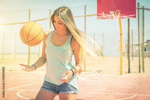 obraz PCV Sporty caucasian girl playing basketball