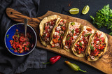 Fototapety Shrimp tacos with homemade salsa, limes and parsley