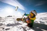 Fototapety Happy snowboarder with kite lies in snowdrift. Sheregesh resort, Siberia, Russia