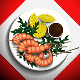 Grilled tiger prawns with lemon and arugula on white plate.