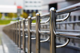 Chromium metal fence with handrail. Chrome-plated metal railings. Shallow depth of field. Selective focus. - 110981889