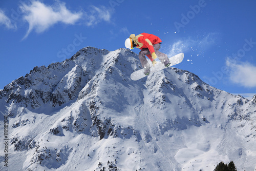 Snowboard rider jumping on mountains Poster