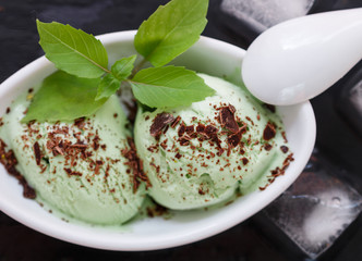 Homemade organic mint ice cream with chocolate. A refreshing summer dessert. Selective focus