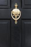 Front door close up of a brass door knocker - 111006627