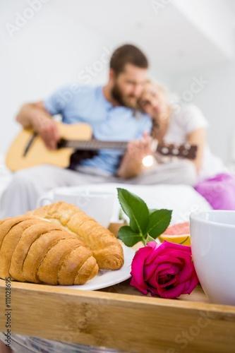 Zdjęcia na płótnie, fototapety, obrazy : Croissant and a rose on tray