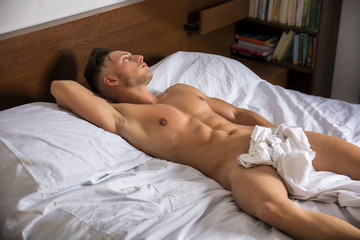 Sexy naked young man on bed © theartofphoto