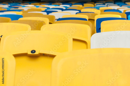 Poster Empty plastic seats in a footbal or soccer stadium