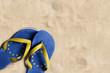 Thongs with flag of European Union, on beach sand